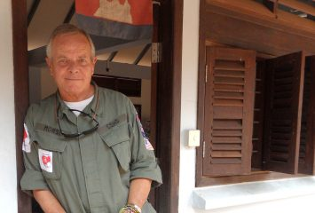 "Bill Morse '71, dressed in the fatigues worn by the demining teams of Cambodian Self-Help Demining (CSHD), an organization dedicated to finding and disarming landmines and unexploded ordnance (UXOs) in parts of Cambodia deemed ""low priority"" by the government's mine-clearing efforts. Photo courtesy of Landmine Relief Fund"